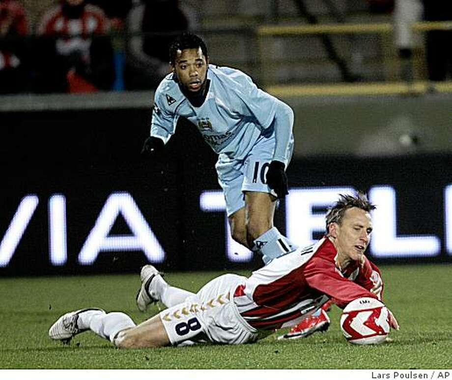 Aalborg�s Andreas Johansson, right, battles for the ball with Manchester City�s Robinho  in their UEFA CUP round of 16 soccer match at Aalborg  Stadium, Aalborg, Denmark, Thursday March. 19, 2009. Photo: Lars Poulsen, AP