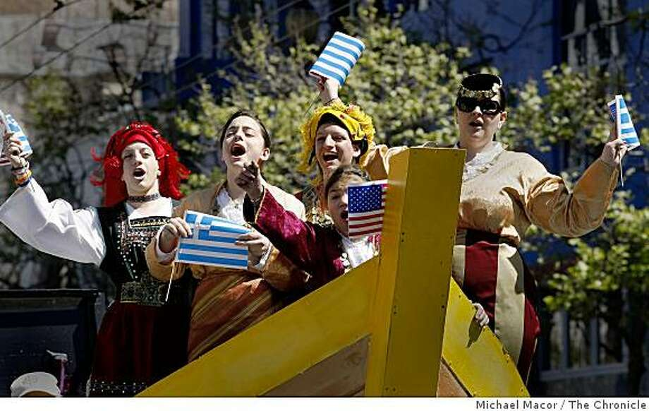 "(left to right)  Sisters, Vicky, Kathryn and Contance Paraskevas are joined by Electra Fourakis and Sofia Savvidis who are all part of the ""Minoan Dancers a traditional Greek dance troop as they ride a boat inspired float during Greek Parade celebrating Greek heritage, moving up Market Street in San Francisco on Saturday March 28, 2009. Photo: Michael Macor, The Chronicle"