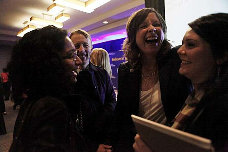 Joy Opfer (second from right), with Kyler by Joy O, is congratulated by friend Priya Saraswati (left), husband Peter Larsen (second from left) and assistant Leslie Fong (right) after being selected as one of 10 winners of the Make Mine a Million $ Business competition on Monday, November 8, 2010 in San Francisco, Calif. Photo: Lea Suzuki, The Chronicle