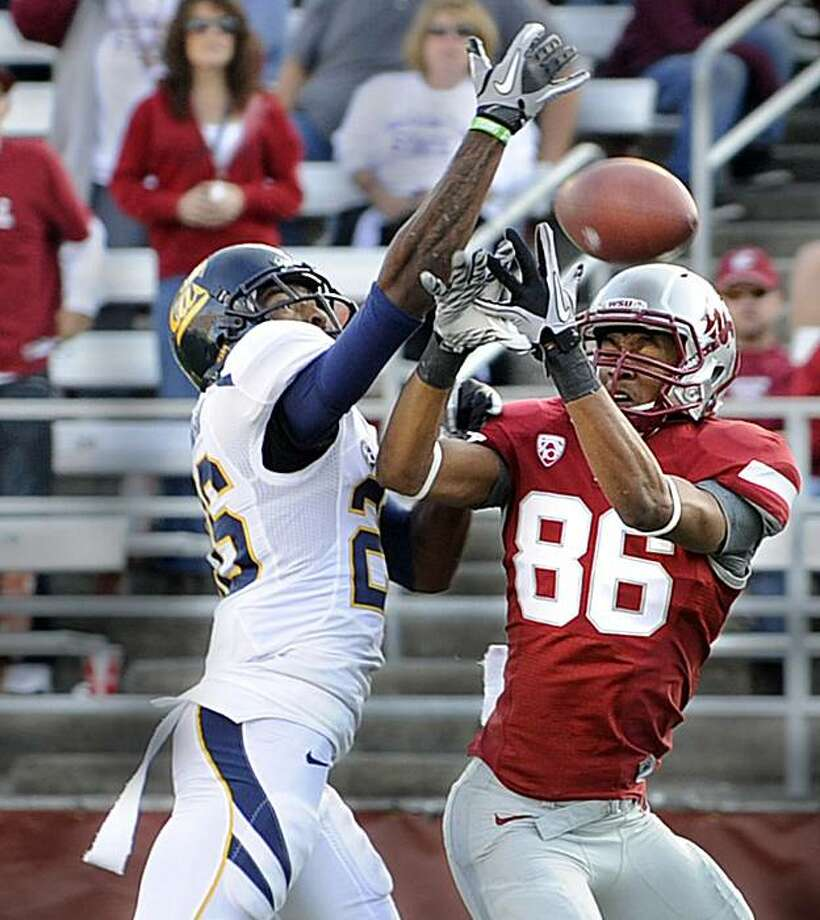 Cal defenisve back Darian Hagan,LEFT,  blocks the pass from Washington State wide receiver  Marquess Wilson during first half of an NCAA college football  game at Martin Stadium in Pullman, Wash. Saturday Nov. 6, 2010.   (AP Photo/The Spokesman-Review, Christopher  Anderson) NO SALES; COEUR D'ALENE OUT; MAGS OUT; TV OUT Photo: Christopher Anderson, AP