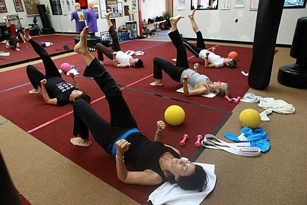 Pam Baer (front) from San Francisco participating in Core-a-te, an exercise class combining karate, self-defense, and core strengthening in San Francisco, Calif., on Monday, August 30, 2010. Photo: Liz Hafalia, The Chronicle