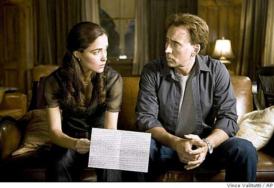 "In this film publicity image released by Summit Entertainment, Nicolas Cage, right, and Rose Byrne are shown in a scene from ""Knowing."" Photo: Vince Valitutti, AP"