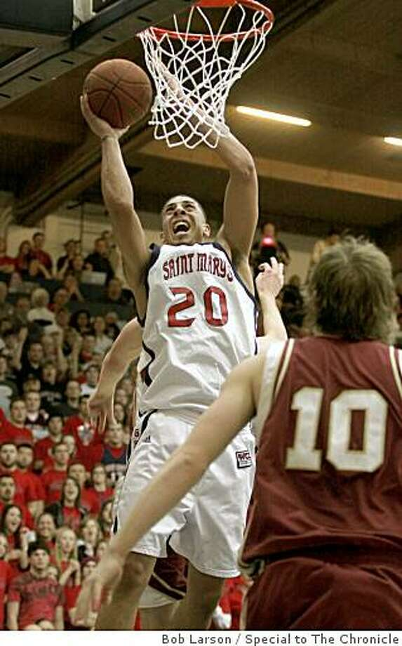 St. Mary's Gaels, Diamon Simpson goes up for the shot as Santa Clara Broncos, Ben Dowdell looks on in the 1st half of their game at St. Mary's College in Moraga Calif., Friday, January 9, 2009.(Special to the Chronicle/ Bob Larson) Photo: Bob Larson, Special To The Chronicle