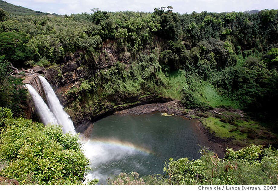 KAUAI_229.jpg_  Kauai Hawaii: A rainbow is cast at the foot of Wailua Falls on Kauai East Coast. By Lance Iversen/San Francisco Chronicle Photo: Lance Iversen