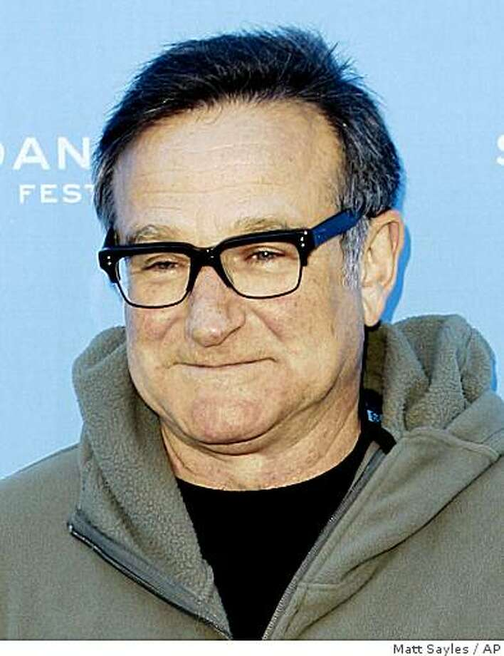 "In this Jan. 18, 2009 file photo, Robin Williams arrives at the premiere of ""World's Greatest Dad"" at the Sundance Film Festival in Park City, Utah. Photo: Matt Sayles, AP"