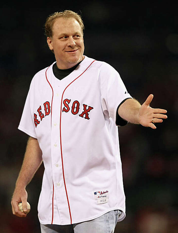"""BOSTON - OCTOBER 16: (FILE PHOTO) Curt Schilling of the Boston Red Sox throws out the first pitch of game five of the American League Championship Series against the Tampa Bay Rays during the 2008 MLB playoffs at Fenway Park on October 16, 2008 in Boston, Massachusetts. Pitcher Curt Schilling announced on his online blog """"38 Pitches"""" that he would retire from baseball on March 23, 2009.  (Photo by Elsa/Getty Images) Photo: Elsa, Getty Images / Getty Images North America"""