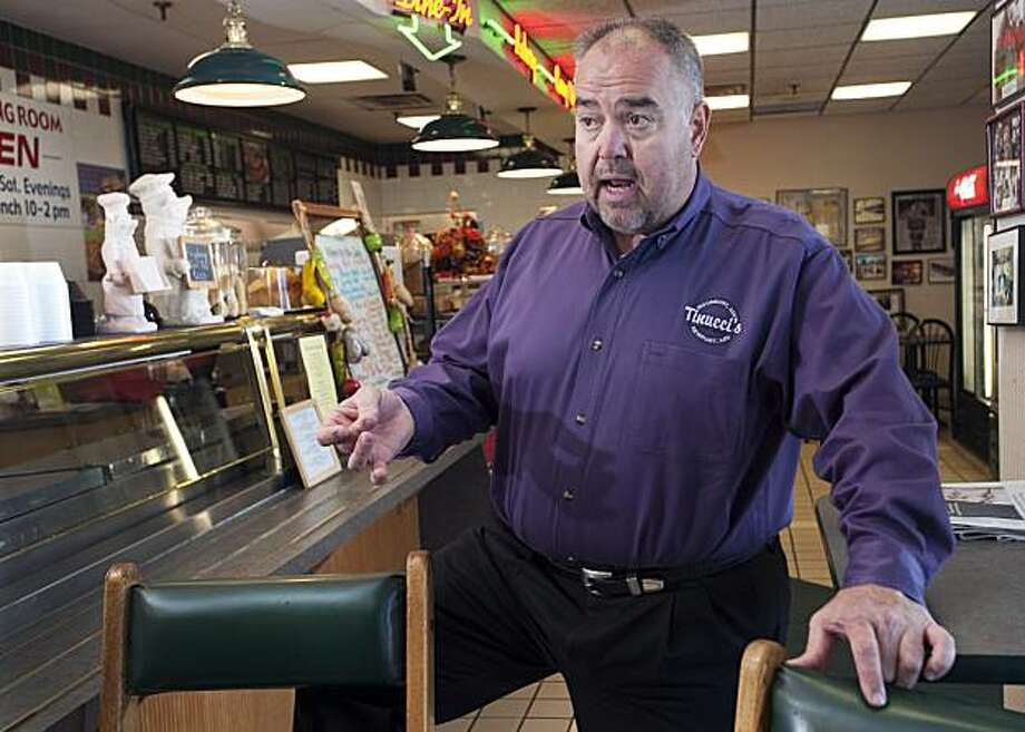 Caterer Gus Tinucci talks about his encounter with NFL football Randy Moss while catering a function for the Minnesota Vikings last week, at Tinucci's store in Newport, Minn., Nov. 4, 2010. Tinucci's plans to offer free lunches Friday to the first 50 people who come to turn in their Moss jerseys, after the Vikings waived Moss after 26 days with the team. Photo: Craig Lassig, AP