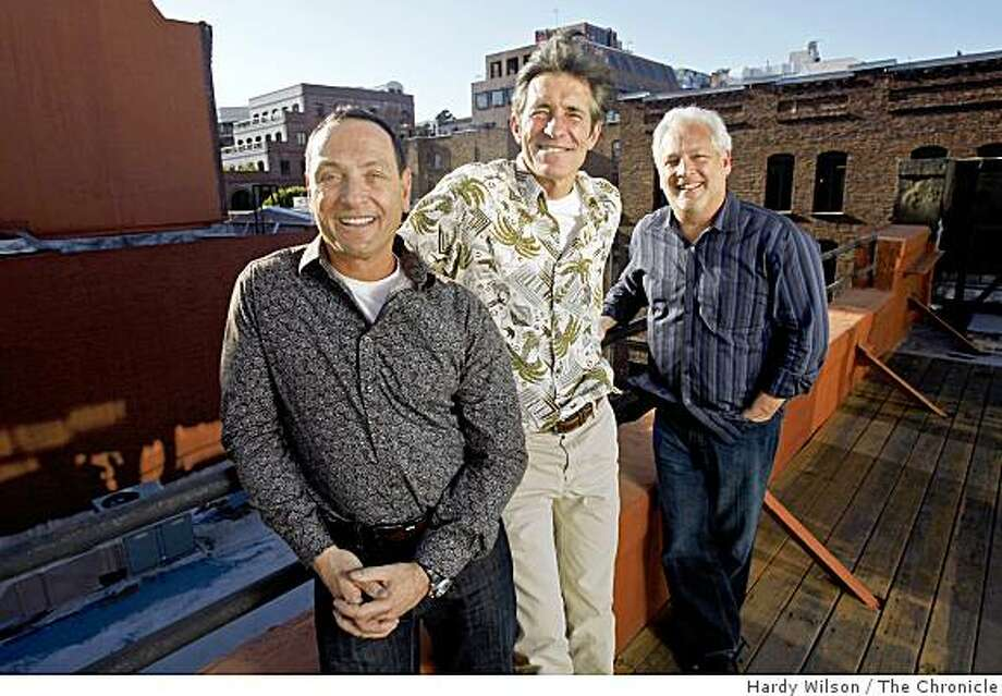Scott Aal, Vince Engel, and Wayne Buder, from left, pose for a photo on the roof of their in their office in San Francisco, Calif., on Friday, March 27, 2009. The three, along with Grant Richards, not pictured, have merged their former ad agencies together to form Engine Company 1, which has taken the space of an old firehouse. Photo: Hardy Wilson, The Chronicle