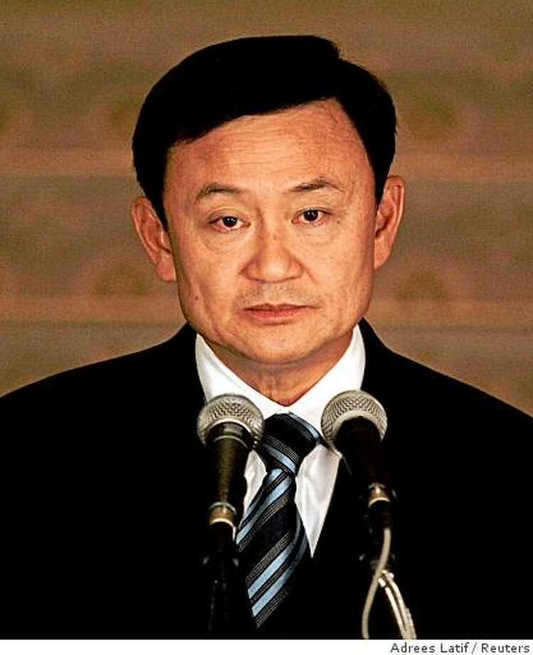 Thai Prime Minister Thaksin Shinawatra pauses while addressing the nation at the Government House in Bangkok April 4, 2006. Thaksin said on Tuesday he would step down to defuse a long-running political crisis, although it remained unclear exactly when. Photo: Adrees Latif, Reuters