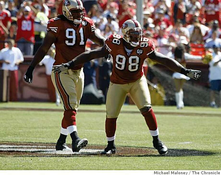San Francisco 49ers Ray McDonald (91) and Parys Haralson (98) celebrate their defensive play.The San Francisco 49ers host the Arizona Cardinals in  their NFL  season opener at Candlestick Park in San Francisco, Calif., on Sept. 7, 2008. Arizona won 23-13. Photo: Michael Maloney, The Chronicle