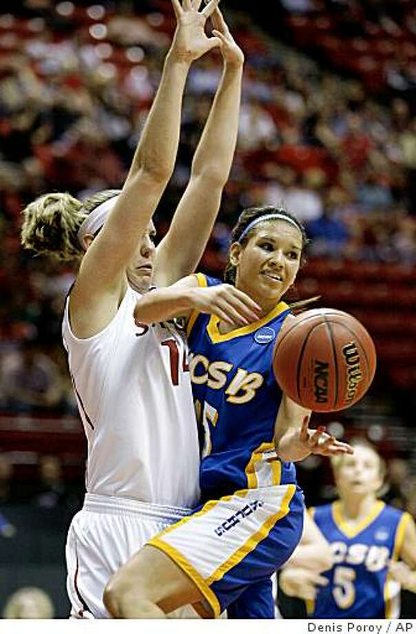 UC Santa Barbara's Lauren Pedersen, right, passes off in front of the defense of Stanford's Kayla Pedersen, left, during the first half of a first-round women's NCAA college basketball tournament game Saturday, March 21, 2009 in San Diego.  (AP Photo/Denis Poroy) Photo: Denis Poroy, AP