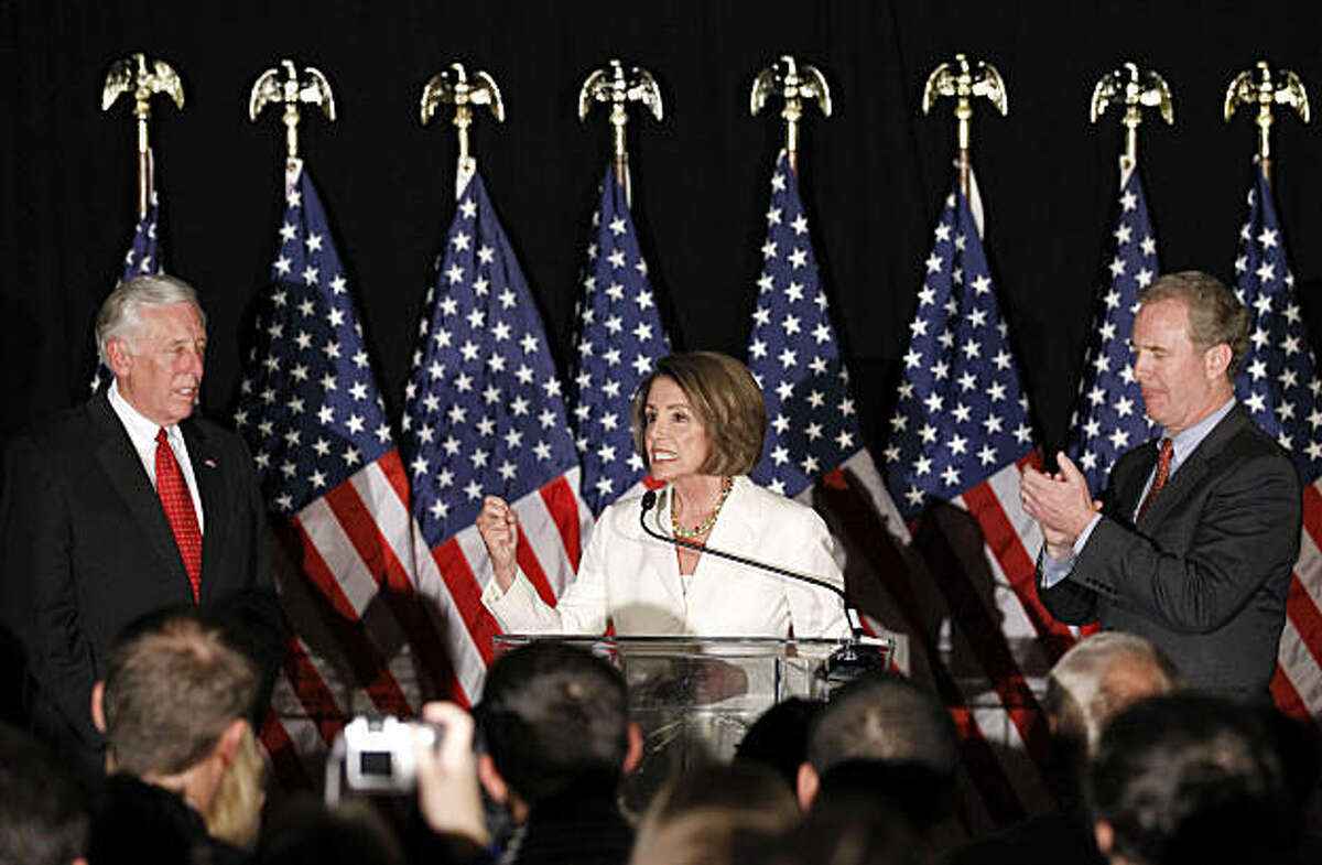 House Speaker Nancy Pelosi, D-Calif., center, accompanied by House Majority Leader Steny Hoyer of Md., left, and Rep. Chris Van Hollen, D-Md., gestures while speaking to supporters at an election night party in Washington, Tuesday, Nov. 2, 2010.