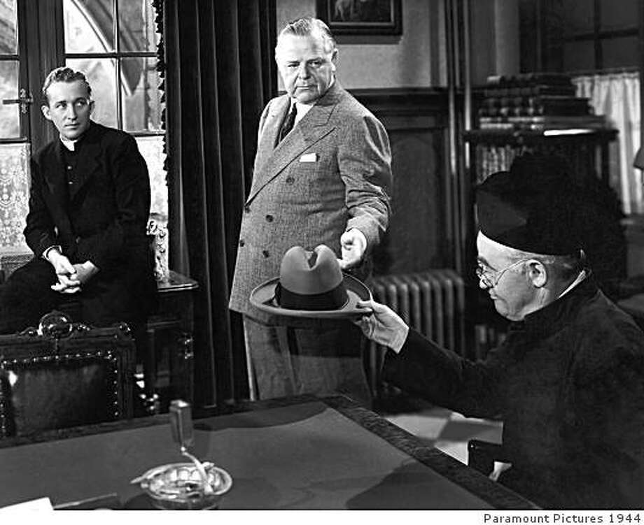 """Bing Crosby (left) and Barry Fitzgerald (right) in """"Going My Way.""""A scene still from the 1944 film """"Going My Way"""" features (l to r) Bing Crosby, Gene Lockhart and Barry Fitzgerald.  Oscar� history was made when Fitzgerald became the first and only actor to be nominated in both the Lead Actor and Supporting Actor categories for the same performance.  This is no longer possible under present Academy voting rules.  Fitzgerald won the Supporting Actor Oscar while his co-star Crosby won the Oscar for Lead Actor. Restored by Nick & jane for Dr. Macro's High Quality Movie Scans Website: http:www.doctormacro.com. Enjoy! Photo: Paramount Pictures 1944"""