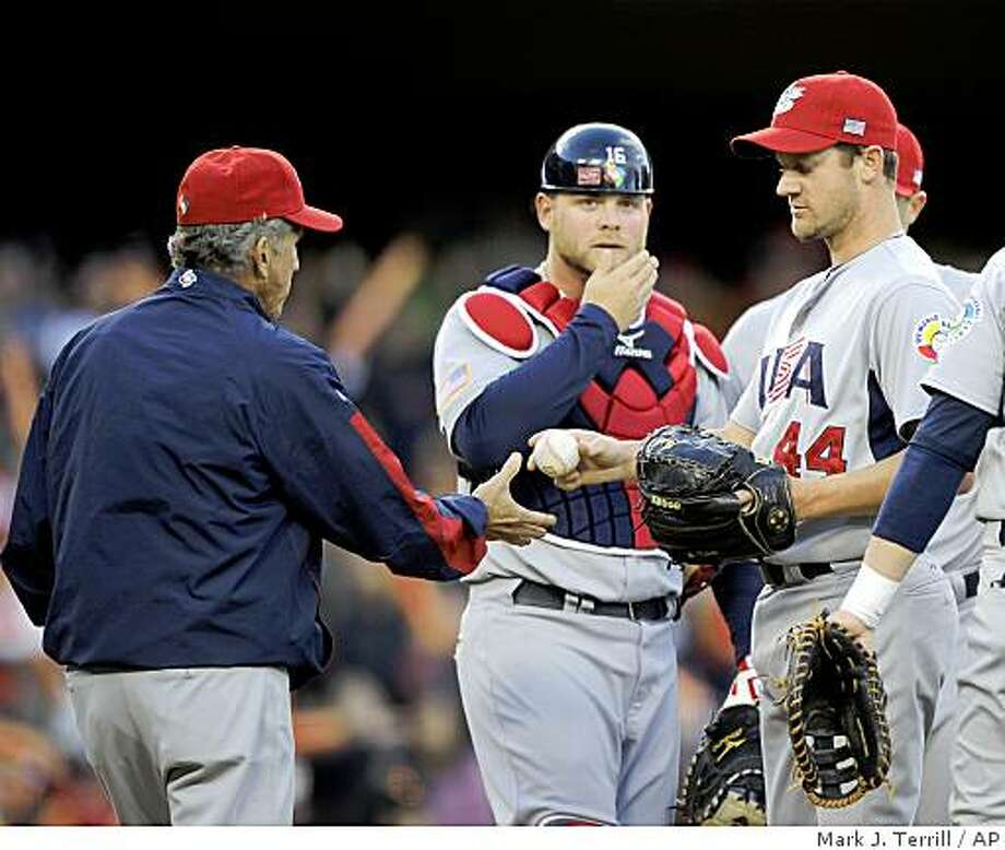 United States starting pitcher Roy Oswalt gives is taken out of the game by manager Davey Johnson during the fourth inning of a semifinal against Japan at the World Baseball Classic in Los Angeles, Sunday, March 22, 2009. (AP Photo/Mark J. Terrill) Photo: Mark J. Terrill, AP