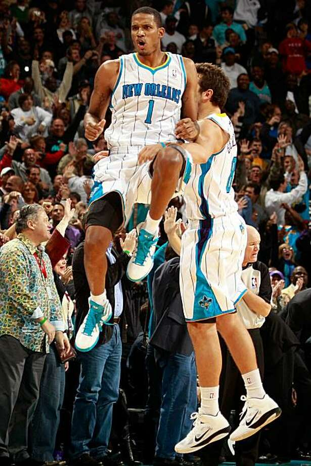NEW ORLEANS - NOVEMBER 05:  Trevor Ariza #1 of the New Orleans Hornets celebrates after making a three point shot near the end of the game against the Miami Heat at the New Orleans Arena on November 5, 2010 in New Orleans, Louisiana.  The Hornets defeatedthe Heat 96-93.  NOTE TO USER: User expressly acknowledges and agrees that, by downloading and/or using this Photograph, User is consenting to the terms and conditions of the Getty Images License Agreement. Photo: Chris Graythen, Getty Images