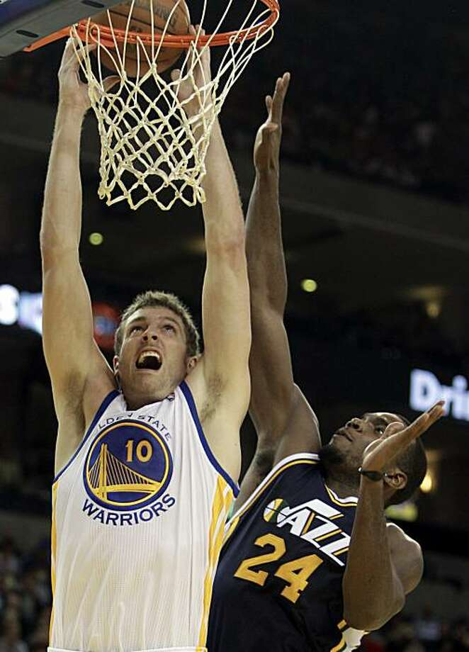 Golden State Warriors' David Lee, left, goes up for a shot over Utah Jazz forward Paul Millsap (24) during the first half of an NBA basketball game Friday, Nov. 5, 2010, in Oakland, Calif. Photo: Ben Margot, AP