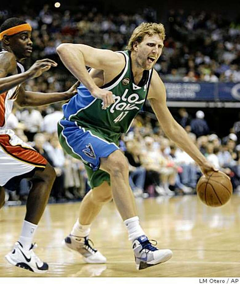 Dallas Mavericks forward Dirk Nowitzki (41), of Germany, drives past Golden State Warriors guard Anthony Morrow during the second half of an NBA basketball game in Dallas, Wednesday, March 25, 2009. The Mavericks won 128-106. (AP Photo/LM Otero) Photo: LM Otero, AP