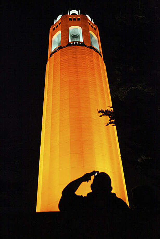 In celebration of the Giants' appearance in the 2010 World Series, various buildings around the City painted with orange lights, including Coit Tower, on Wednesday, October 27, 2010 in San Francisco, Calif. Photo: John Sebastian Russo, The Chronicle