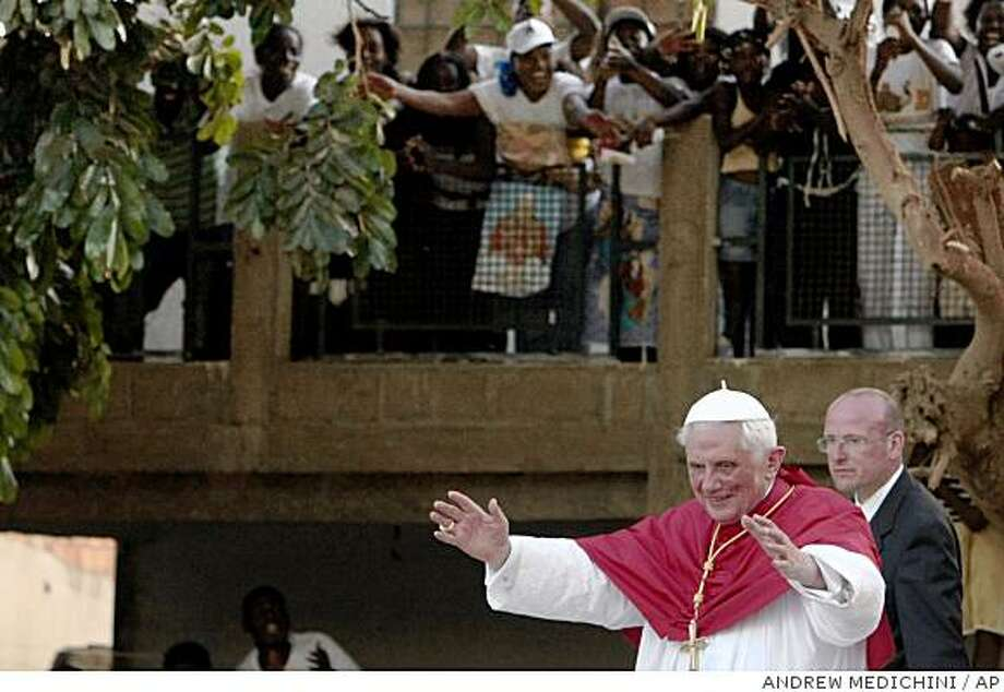 Pope Benedict XVI greets the faithful as he leaves at the end of a meeting with Angolan movements for the promotion of the women in Luanda's Santo Antonio church, Angola, Sunday, March 22, 2009. Pope Benedict XVI is in Africa for a seven-day trip to visit Cameroon and Angola.(AP Photo/Andrew Medichini) Photo: ANDREW MEDICHINI, AP