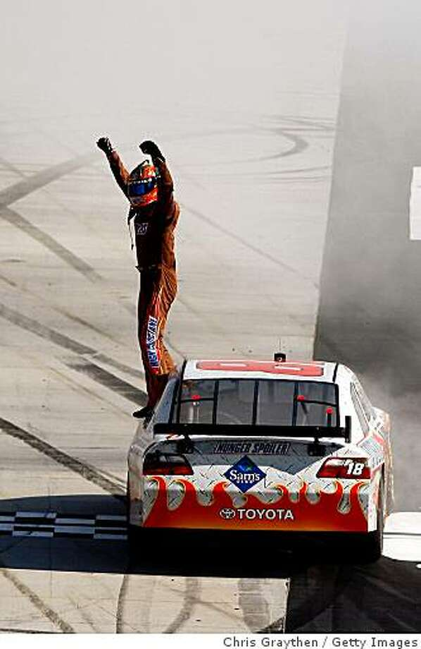 BRISTOL, TN - MARCH 22:  Kyle Busch, driver of the #18 Snickers Toyota, celebrates on the track after winning the NASCAR Sprint Cup Series Food City 500 at Bristol Motor Speedway on March 22, 2009 in Bristol, Tennessee.  (Photo by Chris Graythen/Getty Images) Photo: Chris Graythen, Getty Images