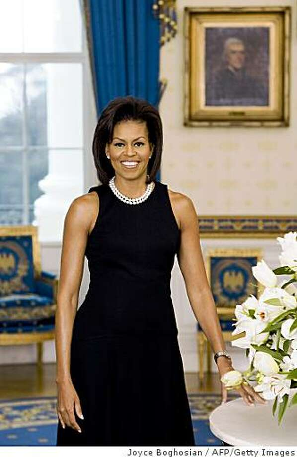 TO GO WITH AFP STORY BY VIRGINIE MONTET(FILES) Filed handout image released on Feberuary 27, 2009 by the White House in Washington, DC, shows First Lady Michelle Obama in her official portrait. The portrait shows Mrs. Obama standing in the Blue Room in a black sleeveless dress with a double strand of pearls. If one woman symbolizes International Women's Day for Americans, and black American women in particular, it's Michelle Obama, the successful career-woman and mother of two who six weeks ago became First Lady, March 6, 2009 AFP reported.AFP PHOTO/HO/THE WHITE HOUSE              = RESTRICTED TO EDITORIAL USE = GETTY OUT = (Photo credit should read JOYCE BOGHOSIAN/AFP/Getty Images) Photo: Joyce Boghosian, AFP/Getty Images