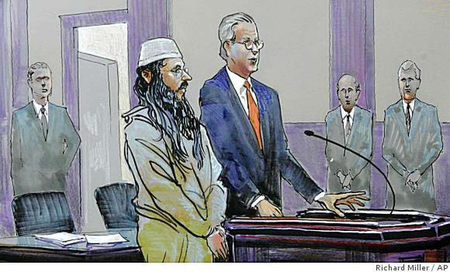 This March 10, 2009 courtroom drawing from U.S. District Court shows alleged al Qaida sleeper agent Ali al-Marri as he made an initial appearance with his attorney Andy Savage, in Charleston, S.C. to face terror charges for the first time after being held for more than five years as an enemy combatant. (AP Photo/Richard Miller) Photo: Richard Miller, AP