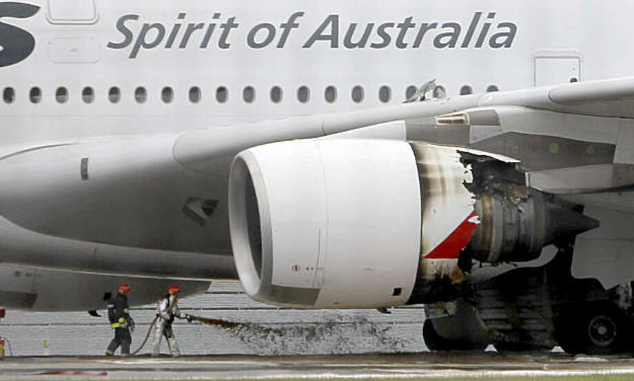 Firefighters surround a Qantas passenger plane which made an emergency landing with 459 people aboard in Singapore's Changi International Airport after having engine problems Thursday, Nov. 4, 2010. Photo: Wong Maye-E, AP