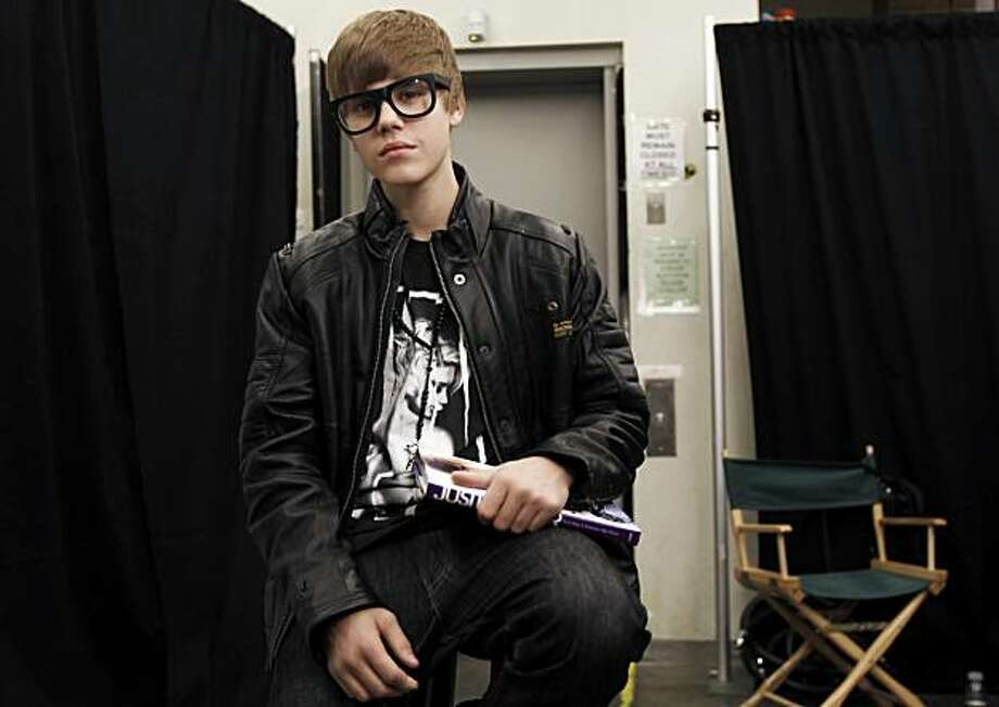 "Musician Justin Bieber poses for a portrait while promoting his new book, ""Justin Bieber: First Step 2 Forever"", in Los Angeles, Sunday, Oct. 31, 2010. Photo: Matt Sayles, AP"