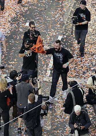 San Francisco Giants relief pitchers Sergio Romo, center left, and Brian Wilson, and center right, celebrate their baseball World Series win during a ticker-tape parade through downtown San Francisco, Wednesday, Nov. 3, 2010. The Giants defeated the TexasRangers in five games for their first championship since the team moved west from New York 52 years ago. Photo: Eric Risberg, AP