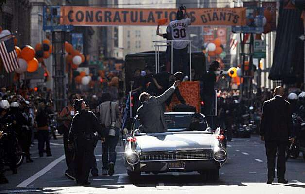Former San Francisco Giants great Willie Mays waves from the back of a car as he rides in the Giants World Series ticker-tape parade through downtown San Francisco, Wednesday, Nov. 3, 2010. The Giants defeated the Texas Rangers in five games for their first championship since the team moved west from New York 52 years ago. Photo: Jeff Chiu, AP