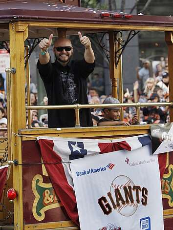 San Francisco Giants center fielder Cody Ross celebrates while riding in a cable car during a baseball World Series parade in downtown San Francisco, Wednesday, Nov. 3, 2010. The Giants defeated the Texas Rangers in five games for their first championshipsince the team moved west from New York 52 years ago. Photo: Paul Sakuma, AP
