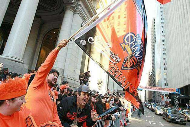 A San Francisco Giants fan waves a flag as he waits for the start of the Giants' victory parade on November 3, 2010 in San Francisco, California. Thousands of Giants fans lined the streets of San Francisco to watch the San Francisco Giants celebrate their 2010 World Series victory over the Texas Rangers. Photo: Justin Sullivan, Getty Images