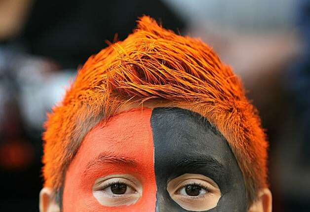 A San Francisco Giants fan wears face paint and has dyed hair as he waits for the start of the Giants' victory parade on November 3, 2010 in San Francisco, California. Thousands of Giants fans lined the streets of San Francisco to watch the San Francisco Giants celebrate their 2010 World Series victory over the Texas Rangers. Photo: Justin Sullivan, Getty Images