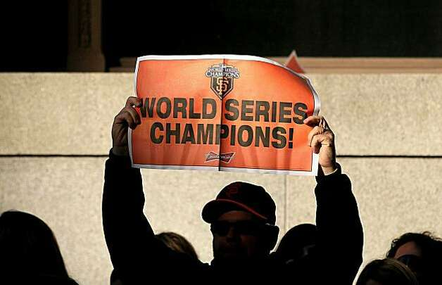 A San Francisco Giants fan holds a sign as he waits for the start of the Giants' victory parade on November 3, 2010 in San Francisco, California. Thousands of Giants fans lined the streets of San Francisco to watch the San Francisco Giants celebrate their 2010 World Series victory over the Texas Rangers. Photo: Justin Sullivan, Getty Images