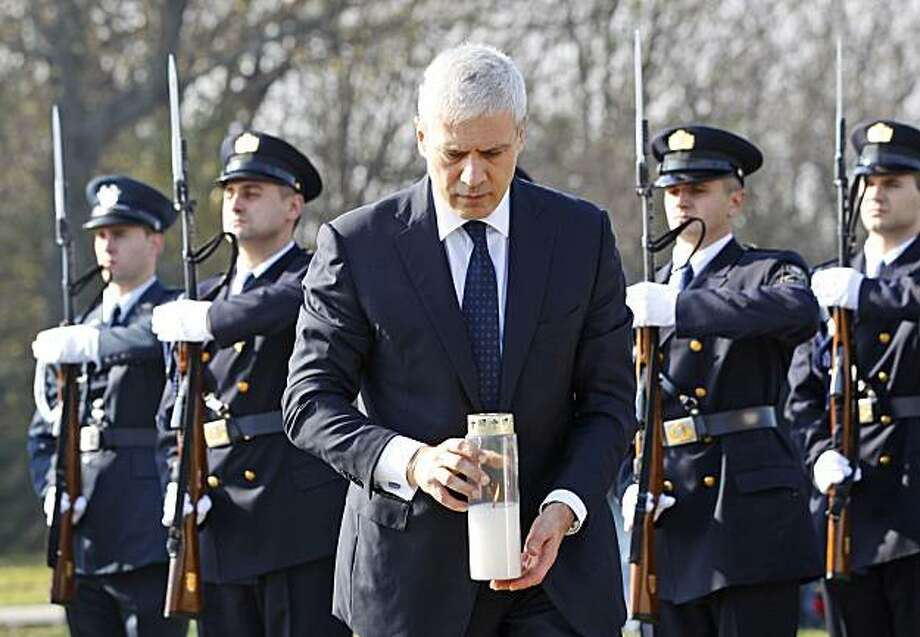 Serbian President Boris Tadic holds a candle as he pays respect at a pig farm Ovcara  where more than 200 Croats dragged out of a local hospital were slain by Serbs when they seized Vukovar, eastern Croatia, Thursday, Nov. 4, 2010. Tadic became his country's first leader to come to Vukovar since the 1991 war, when Serbs' relentless bombardment leveled the town to the ground, leaving scores of Croats dead and forcing others out. Photo: Darko Bandic, AP