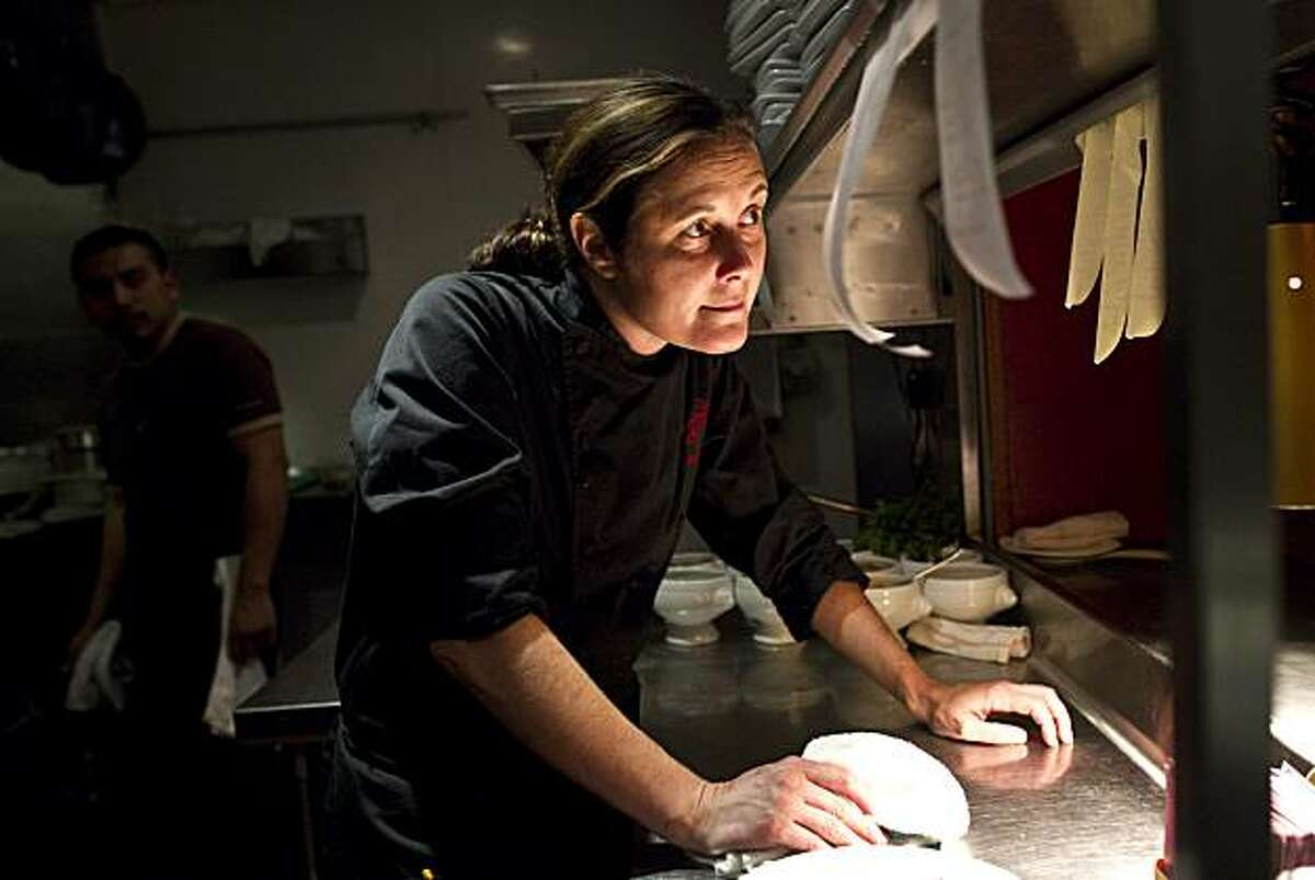 Gitane Executive Chef Bridget Batson talks with the manager while working at the restaurant in San Francisco, Calif., on Thursday, October 28, 2010.