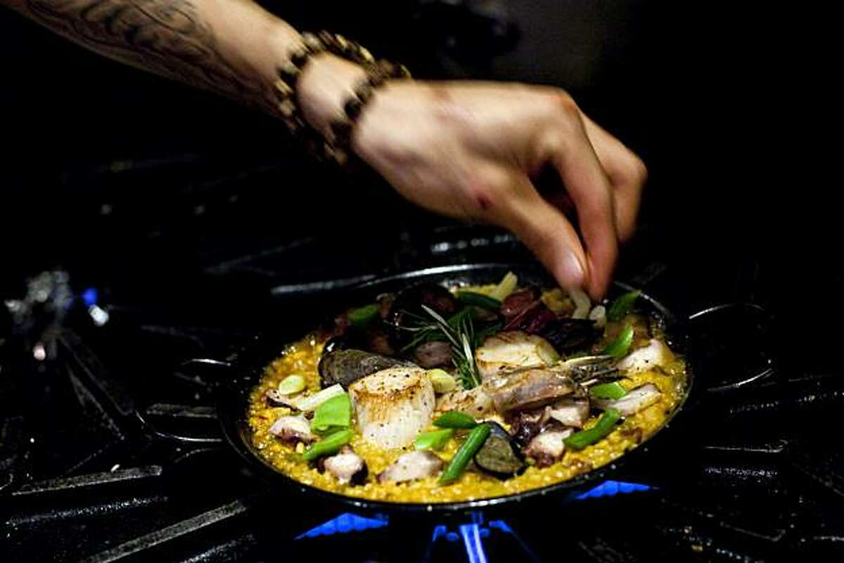 Sous-chef Jason Morales works on cooking a dish of paella at Gitane in San Francisco, Calif., on Thursday, October 28, 2010.