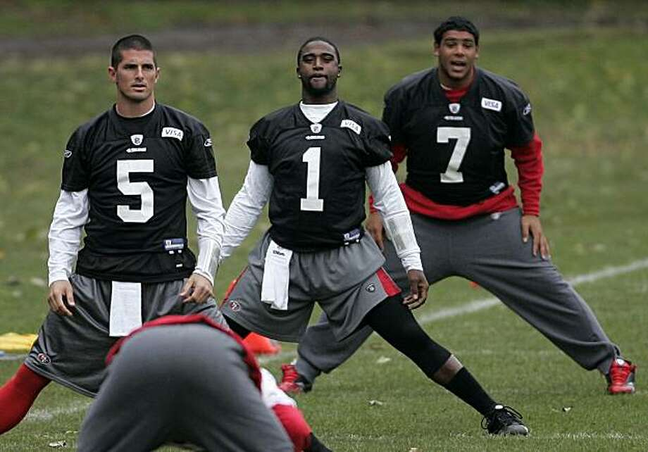 San Francisco 49ers quarterbacks, from left, David Carr, Troy Smith and Nate Davis take part in a practice session at their base in Watford, England, Friday, Oct. 29, 2010. San Francisco 49ers will play against Denver Broncos in a NFL regular season football game  at Wembley Stadium in London on Sunday, Oct. 31. Photo: Akira Suemori, AP