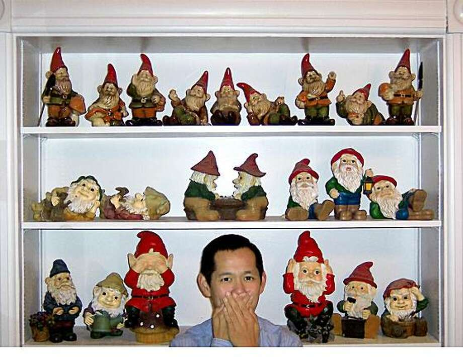 My name is Alexander Agbay, and I am a gnome-sick person in recovery. It has been 1 years and 2 days since I last purchased a gnome or gnome-related item. (I did download a few desktop backgrounds and ringtones from Travelocity.com last week, but they were free. They don?t count!)In 2001, I came down with gnome sickness ? a serious condition in which the victim develops an extreme addiction to collecting gnomes and all things gnome-related. Mine was a rare strain: a gnome-socomial [nosocomial] infection that I acquired in the hospital. My co-worker Susan Gregory, a fellow RN at UCSF Medical Center, surprised me with a seemingly benign garden gnome. She knew I was back in school, so she gave me a gnome that was carrying a book ? and the gnome sickness (Gnomeucoccal ridiculum). The little gnome was quite infectious. Who could resist that cherubic face, those big blue eyes, those Vulcan-esque ears, and that pointy red hat? As the proud new owner of the gnome, I decided to display him in our break room for the rest of our 12-hour shift. A short time later, Susan called me in a panic. She said my gnome had taken a turn for the worse. She intercepted me in the hallway and led me not to the break room, but to one of our palliative care rooms. There, peeking out from under the crisp white sheets was a pointy red hat. Fearing the worst, I cautiously pulled off the sheets, afraid that I would find him broken in several pieces. But he wasn?t; he was alright! I was relieved. Susan had only been playing a practical joke on me. Everything was okay. Or was it? Within a few days, the full-blown symptoms of gnome sickness appeared. I was window-shopping at a discount store ? gname withheld to protect my sources ? and I found a few more gnomes. My heart started pounding and my heart rate went up. My palms got sweaty. And I developed a burning sensation in my wallet. I bought them all, each one with a unique pose. Then I realized that if this discount store had gnomes, perhaps t