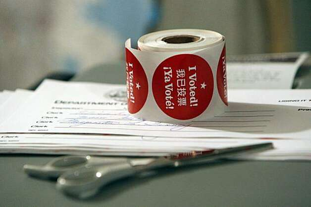 """I Voted"" stickers sit on a ballot collection machine in Elisa Kennedy's garage, a Sunset District precinct, Tuesday, November 2, 2010. Photo: Erin Lubin, Special To The Chronicle"