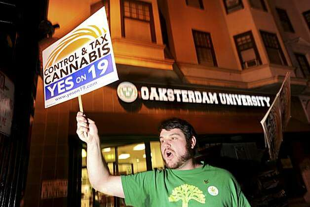Daniel Costa, a volunteer with the campaign to legalize marijuana, rallies last minute voters to support Proposition 19 shortly before polls closed on Tuesday, Nov. 2, 2010, in Oakland, Calif.  If passed, the California proposal would let adults possess up to an ounce of pot, consume it in private places as long as no children were present and grow it in small private plots. Photo: Noah Berger, AP