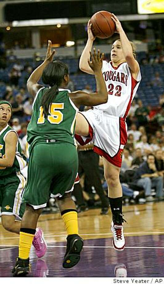 Carondelet from Concord guard Hannah Huffman (22) shoots over Brea Olinda defender Alexis Riley Perry (15) during the second half of the girls Division II CIF state basketball championship game in Sacramento, Calif., Friday, March 20, 2009. Brea Olinda won 68-45. (AP Photo/Steve Yeater) Photo: Steve Yeater, AP