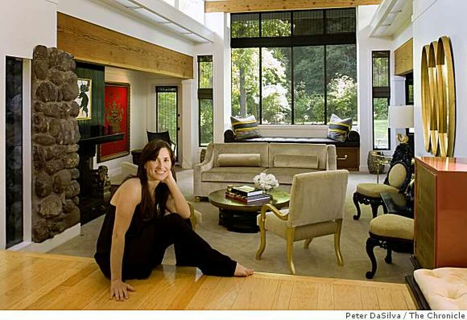 Zem Joaquin in her living room where the use of sustainable forest woods, natural rubbers filled furniture cushions, antiques and swap meet finds help create her eco-friendly home in San Francisco, California, Mar. 21, 2008. Photo: Peter DaSilva, The Chronicle