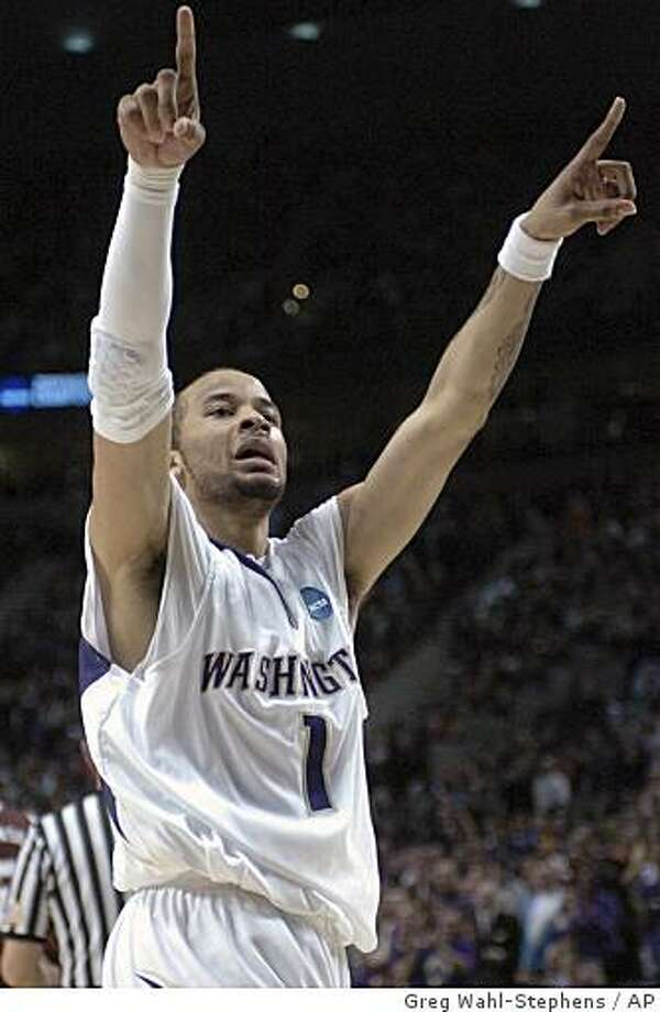 Washington's Venoy Overton (1) gestures to the crowd  during the second half of a first-round men's NCAA basketball tournament game against Mississippi State in Portland, Ore., Thursday, March 19, 2009. (AP Photo/Greg Wahl-Stephens) Photo: Greg Wahl-Stephens, AP