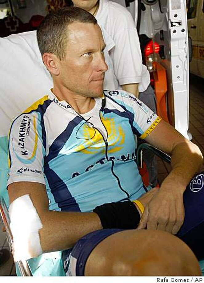 Lance Armstrong of the U.S. is seen in an ambulance as he arrives at Hospital Clinico in Valladolid, Spain, Monday March 23, 2009. Armstrong fractured his collarbone Monday in a crash during the Vuelta of Castilla and Leon race, disrupting the seven-time Tour de France champion's comeback. Armstrong said he would fly to the United States and meet with medical experts to decide whether he needs surgery, leaving in question his participation in the Tour de France in July.(AP Photo/Rafa Gomez, Cyclismo A Fondo) Photo: Rafa Gomez, AP