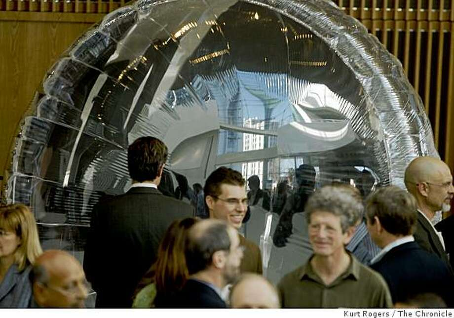 People at the fourth annual California Clean Tech Open look at the Cool Earth Solar Balloon in San Jose, Calif., on March 19, 2009. The mylar reflector collects sun light. Photo: Kurt Rogers, The Chronicle