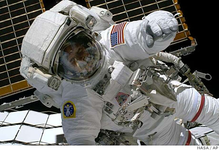 In this image provided by NASA Astronaut Steve Swanson participates in the mission's first scheduled spacewalk to connect the S6 truss segment to the International Space Station Thursday March 19, 2009. The blackness of space and Earth's horizon provide the backdrop for the scene. On Saturday afternoon, astronauts Steven Swanson and Joseph Acaba are scheduled to float out of the linked space station and shuttle to do some chores that will ease the burden for future spacewalkers. (AP Photo/NASA) Photo: NASA, AP