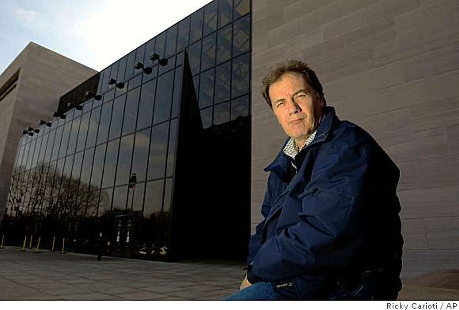 Richard Pullman, who works at the Smithsonian Institution, sits in front of the National Air and Space Museum in Washington on March 11, 2009. In a whistleblower complaint, Pullman alleged Tuesday, March 17, 2009 that the Smithsonian Institution didn't properly contain asbestos-laden dust from construction at the National Air and Space Museum and penalized him after he complained. Photo: Ricky Carioti, AP