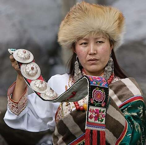 Lhamo, one of the characters of TIBET IN SONG, explaining the costume which her grandmother sent from Tibet. Photo: David Huang