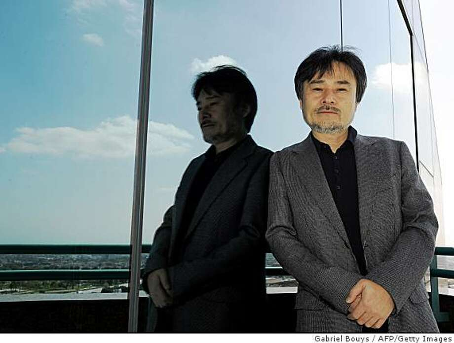 """Japanese director Kiyoshi Kurosawa poses in Los Angeles on March 10, 2009 during a press day for the promotion of his new film """"Tokyo Sonata."""" The film is the story of an ordinary Japanese family which slowly disintegrates after its patriarch loses his job at a prominent company.          AFP PHOTO/Gabriel BOUYS (Photo credit should read GABRIEL BOUYS/AFP/Getty Images) Photo: Gabriel Bouys, AFP/Getty Images"""